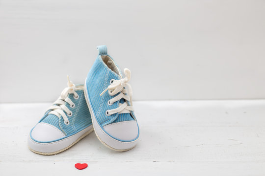 little baby shoes on white background
