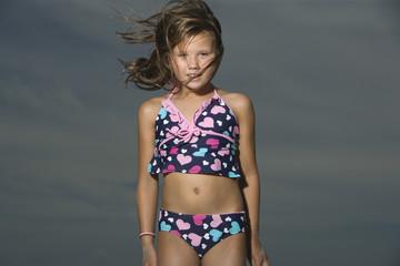 Portrait of a little girl standing on a beach