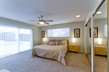 View of a luxury and spacious bedroom in a house