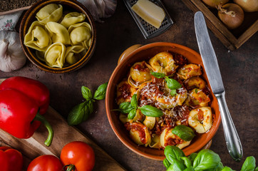 Homemade tortellini with tomato sauce
