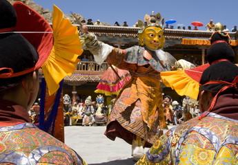 Monk in wooden mask in traditional costume, dancing in monastery courtyard, Hemis Festival, Hemis, Ladakh, India, Asia