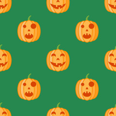 Seamless pattern with halloween pumpkins on green background. Vector texture.
