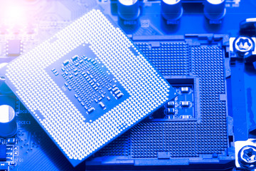 Macro photo of Computer microprocessor on blue background.