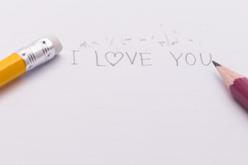 """closeup of text """" I LOVE YOU"""" with  pencil eraser and pencil"""