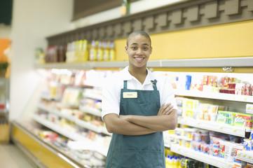 Portrait of a smiling male teenage supermarket employee