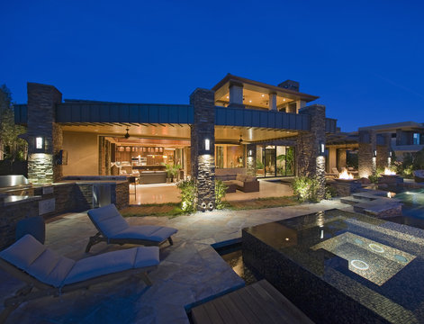 Exterior of contemporary house with plunge pool at dusk
