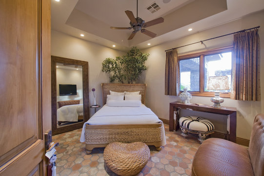 Interior of modern bedroom with rattan
