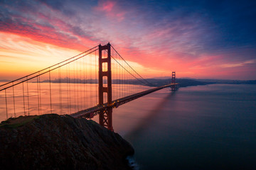 Fototapete - Dramatic Golden Gate Bridge sunrise