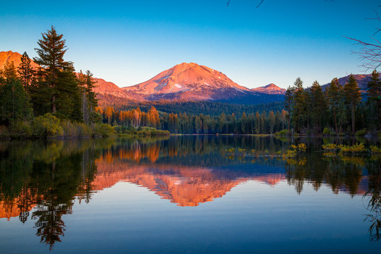 Sunset at Lassen Peak with reflection on Manzanita Lake