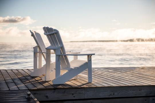 Adirondack Muskoka chairs on the dock at sunrise