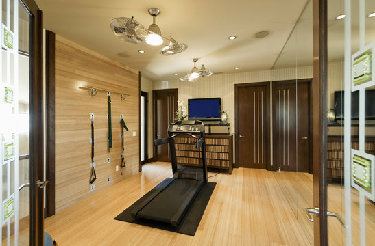 Treadmill and resistance band in gym at home