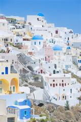 Orthodox churches and stuccoed colorful houses, Oia, Santorini, Cyclades Islands, Greek Islands, Greece, Europe