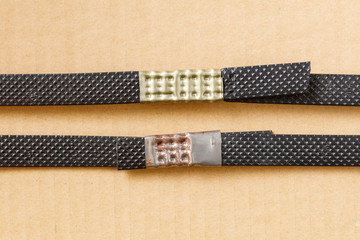 Plastic poly strap with metal clamp