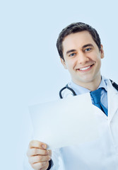 smiling doctor with signboard, on blue