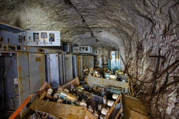 Abandoned old ore mine shaft tunnel passage underground electrical station