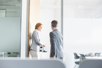 Business people entering into conference room