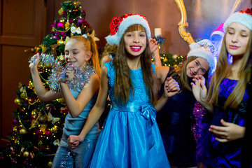 Group of cheerful young girls celebrating Christmas