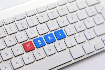 SKI writing on white keyboard with a snowflake sketch
