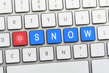 SNOW writing on white keyboard with a snowflake sketch