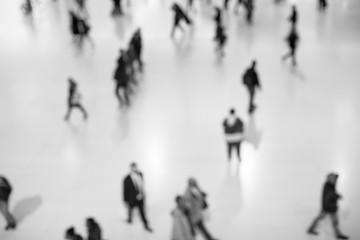 Blurred walking people from top, black and white picture