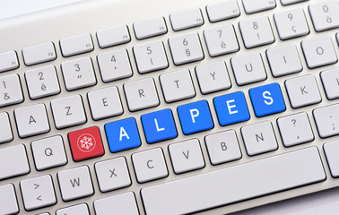 ALPES writing on white keyboard with a snowflake sketch