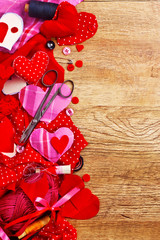 manufacturing soft valentine on Valentine's Day, Handmade Desktop for soft heart of various fabrics and ribbons on wooden background