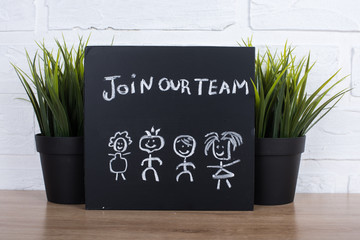 join our team text write on blackboard