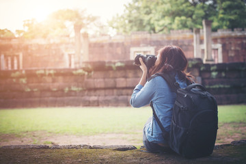 Young attractive woman photographer tourist with backpack.