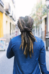 African american man with dreadblocks in the street.