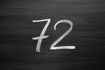 number seventy two enumeration written with a chalk on the blackboard