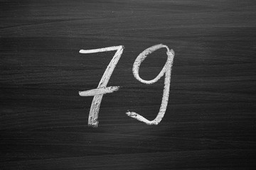 number seventy nine enumeration written with a chalk on the blackboard