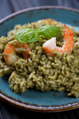 Close-up of spinach and tiger shrimps risotto, studio shot