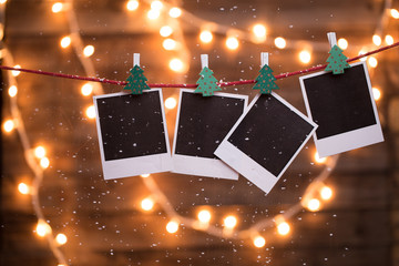 Blank instant photographys with garland
