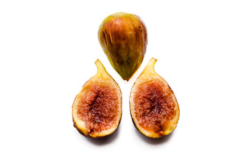 Close up view of figs on white table background
