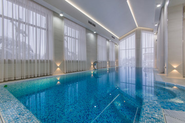 Luxury indoor pool with waterfall jet