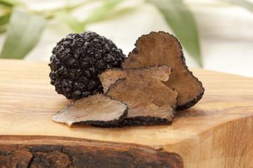 Black Chinese truffle mushrooms on chopping board
