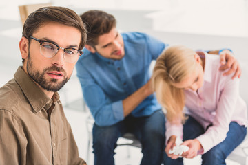 Couple sitting in office of advisor