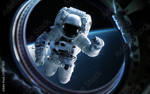 Fototapete Earth planet and astronaut in space ship window porthole. Elements of this image furnished by NASA