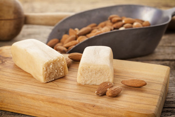 Marzipan and almonds on rustic kitchen table
