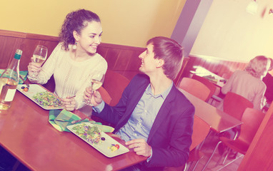 Young man and girl chatting as having date