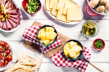 Tasty fresh raclette buffet with side dishes