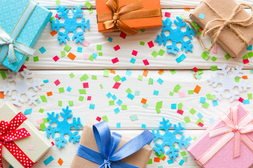 gift boxes on background with confetti and space for text