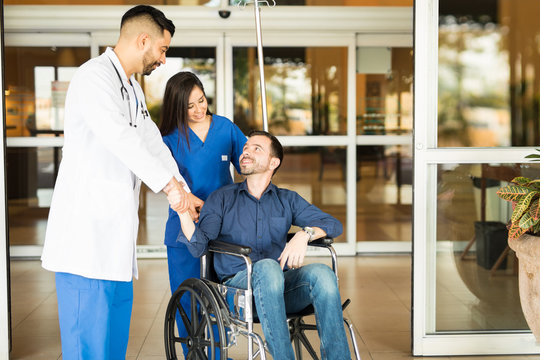 Patient leaving the hospital on a wheelchair