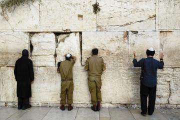 Jewish men praying at Wailing Wall, Jerusalem, Israel