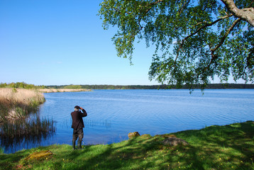 Birdwatching by a calm lake