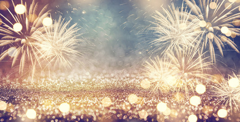 Vintage gold and green Fireworks and bokeh in New Year eve and copy space. Abstract background holiday.