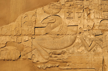 Ancient Egypt. wall are decorated with carved hieroglyphs. Karnak Temple. Luxor. Thebes.