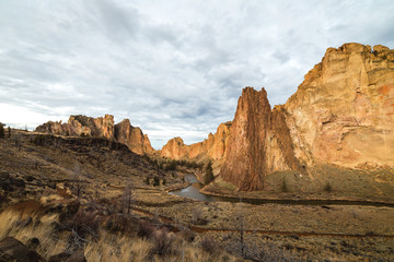 Smith Rock in Oregon with cloudy skies above.