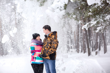 Winter snowfall, couple smiling in snowy winter day
