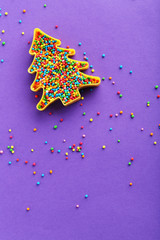 Colorful sprinkles on a purple background